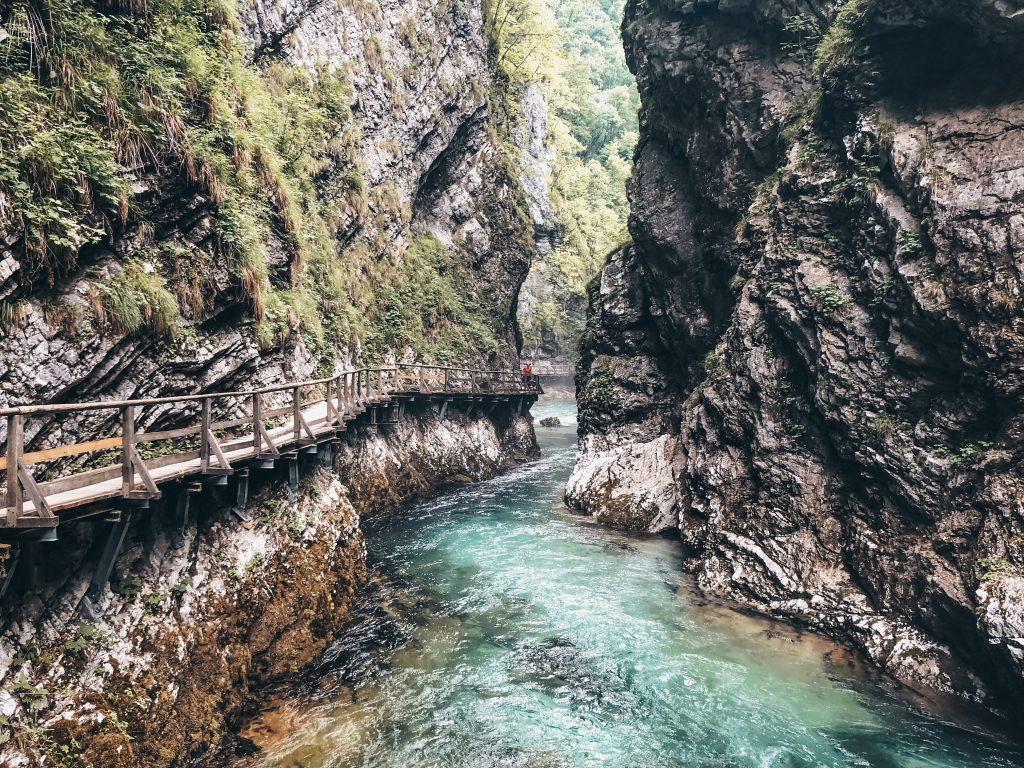 """<img src=""""Vintgar Gorge Slovenia Twovelers.jpg"""" alt=""""Vintgar Gorge in Slovenia hiking trails in Triglav national park"""" srcset="""