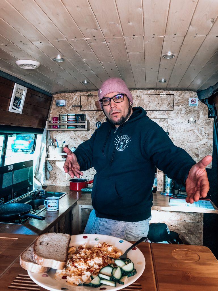 """<img src=""""twovelers blog- vanlife-bevan.jpg"""" alt=""""breakfast in bed bevan campervan """">"""